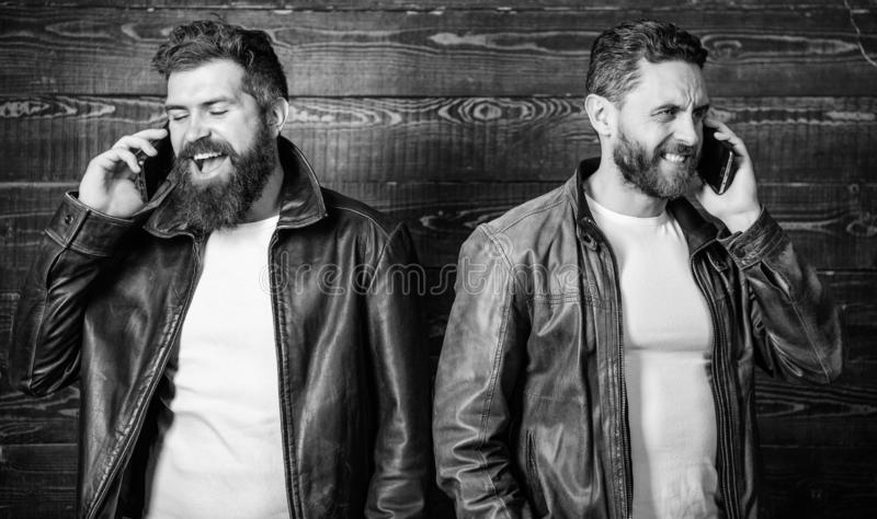 Men with smartphones discuss business. Mobile conversation and connect. Business call. Men brutal bearded hipster in stock photo