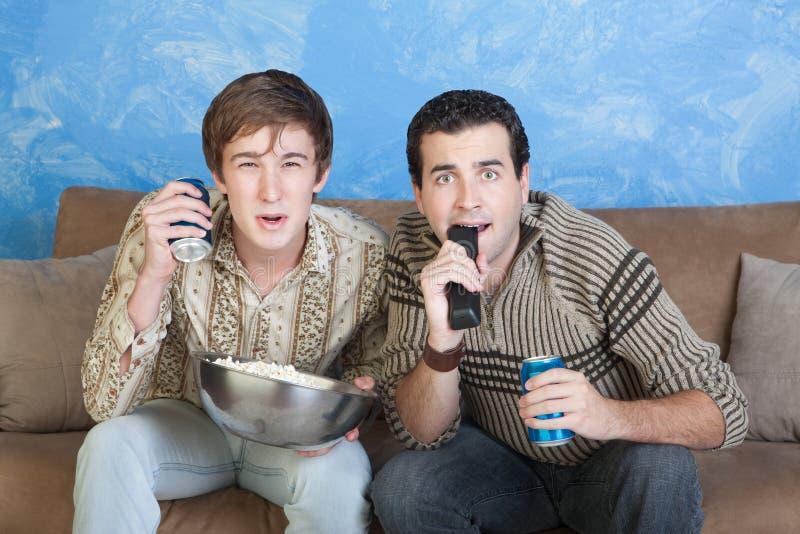 Download Men on Sofa Edge stock photo. Image of calm, buddy, chew - 22215366