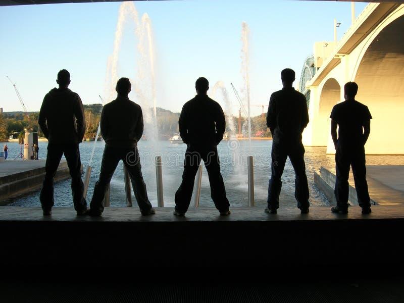 Men standing stock photography