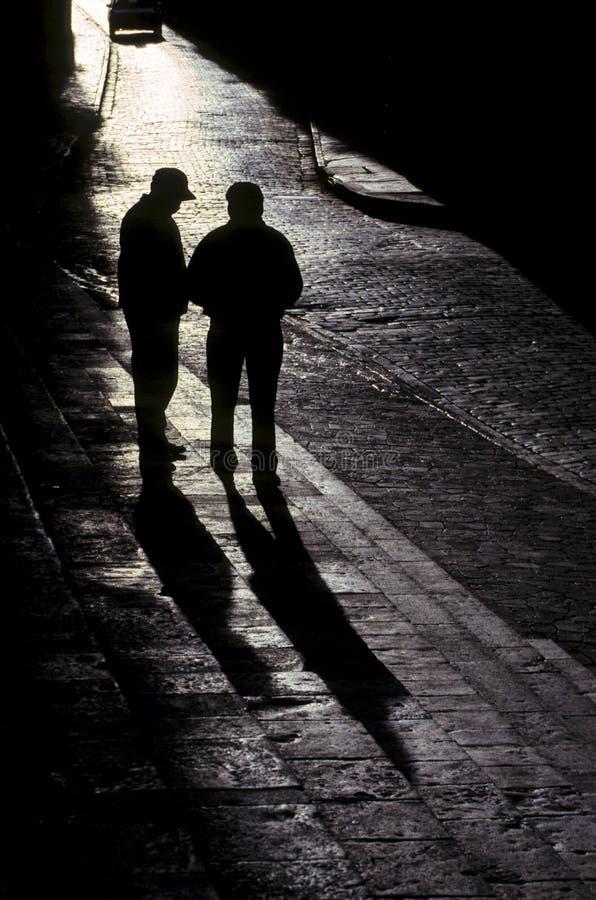 Men on street- Cusco, Peru stock photography