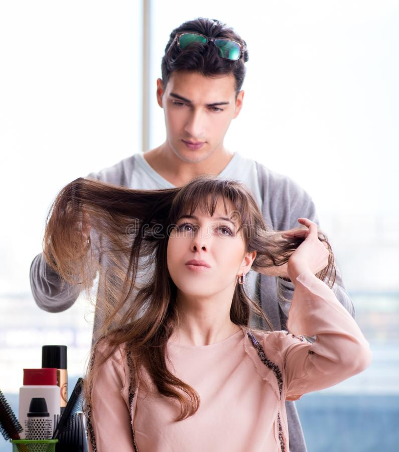 Man stylist working with woman in beauty salon royalty free stock photos