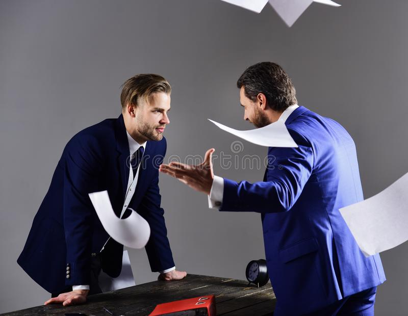 Men in suit or businessmen with unhappy expression with paper. Documents or contracts on dark background. Unfavorable deal concept. Businessman rejects the royalty free stock photography
