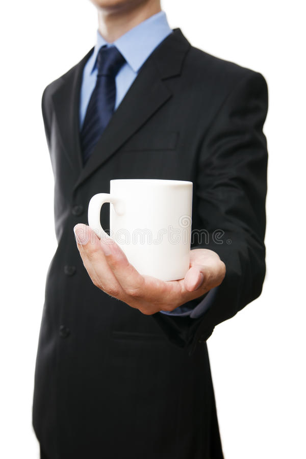 Men in a suit with a cup in hand royalty free stock images