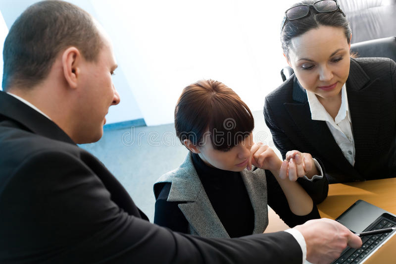 Men in suit with girl and women with notebook. Men in black suit with pen and girl and women with notebook royalty free stock photo