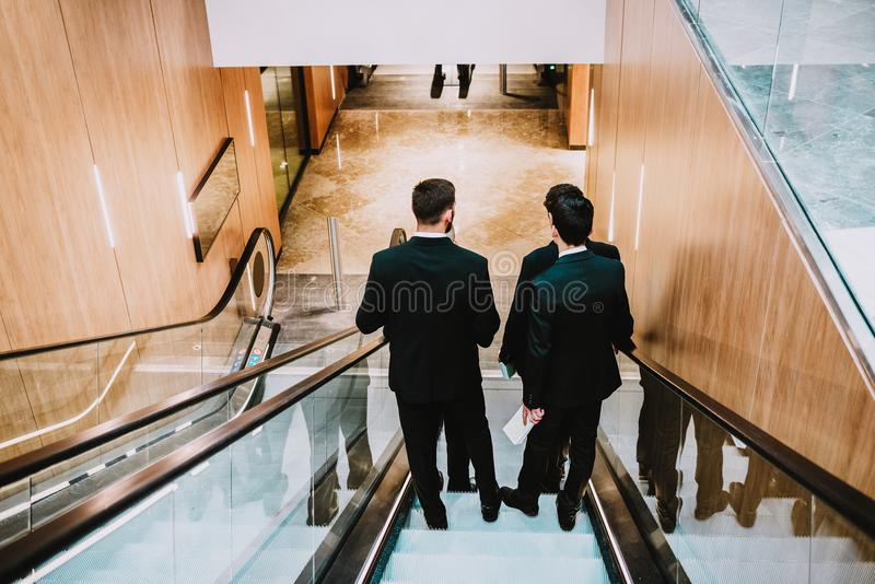 4 men in suit in the shopping center or buisnes center. stock photo