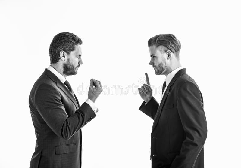 Men in suits or businessmen with tense faces and gestures . Men in suits or businessmen with tense faces and gestures speaking. Business misunderstanding stock photo