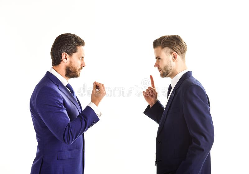Men in suits or businessmen with tense faces and gestures . Men in suits or businessmen with tense faces and gestures speaking. Business misunderstanding royalty free stock images