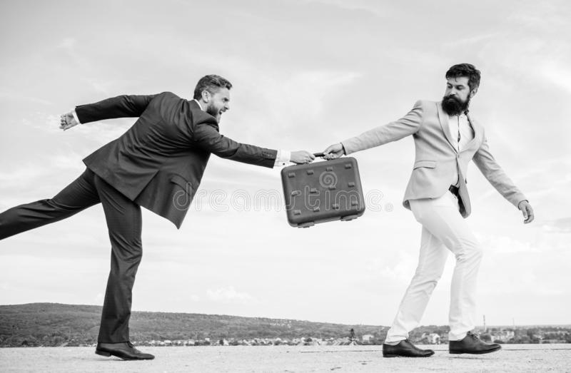 Men suits handover briefcase. Rascal racketeer extortionist cheating business transaction. Risky transaction. Fraud and. Extortion concept. Businessman takes royalty free stock photos