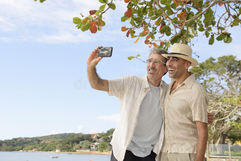 Men taking a selfie with mobile phone royalty free stock images