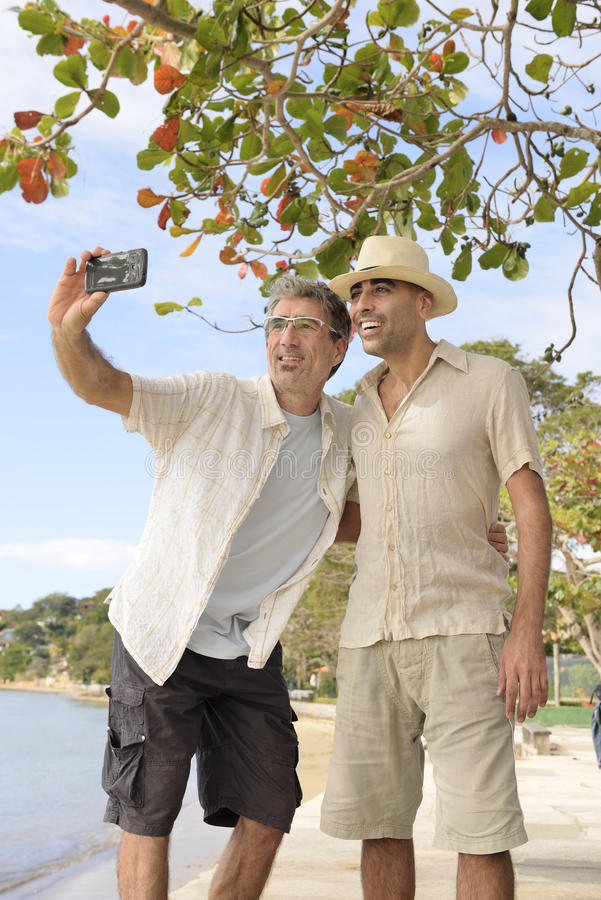 Men taking a selfie with mobile phone royalty free stock photo