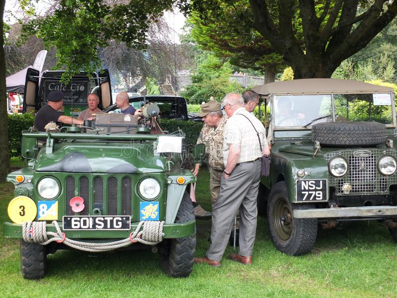Men talking around old military vehicles in the public park at hebden bridge annual vintage weekend royalty free stock image