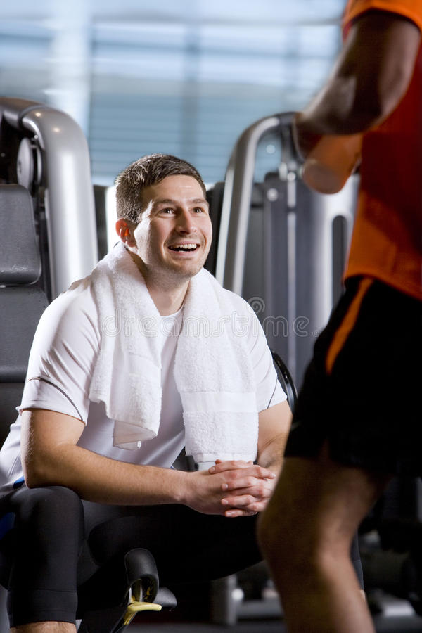 Men talking in health club royalty free stock images
