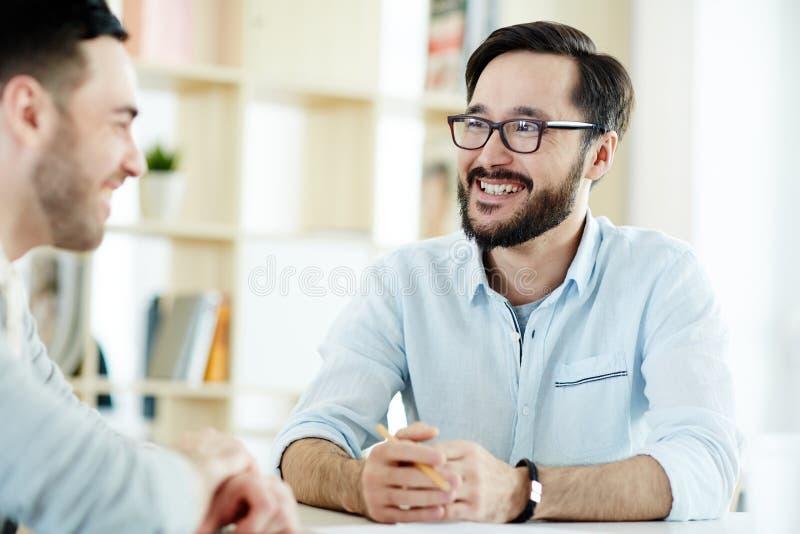 Men talking at meeting stock photo