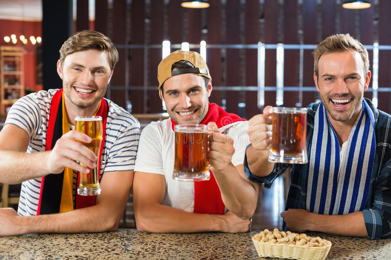 Men toasting with beers royalty free stock images