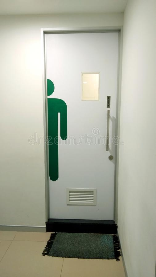 Men toilet room e.ntrance door. stock images