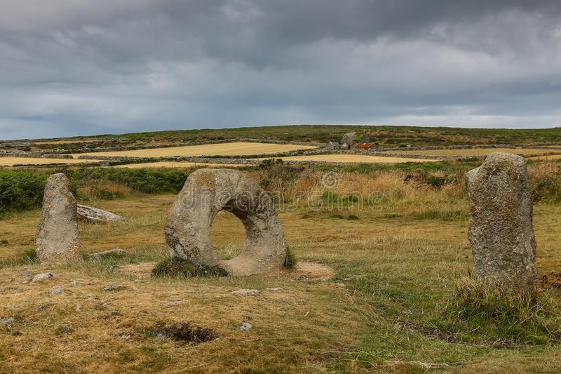 Men an Tol stones, Cornwall. Men an Tol, in Cornish means `stone the hole`, standing stones are located near Madron in Cornwall, England royalty free stock photos