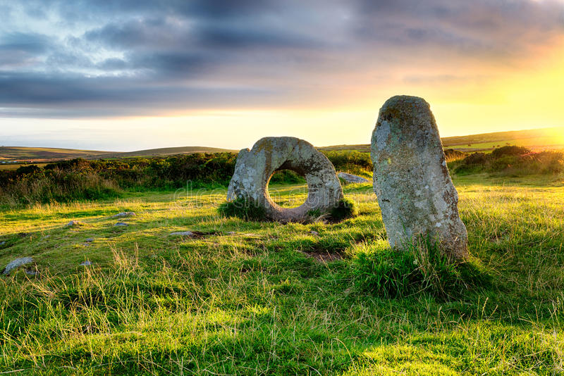 Men-An-Tol in Cornwall. The Men-an-Tol standing stones Near Penzance in Cornwall, local legend says that a person passing through the holed stone can cure many royalty free stock photo