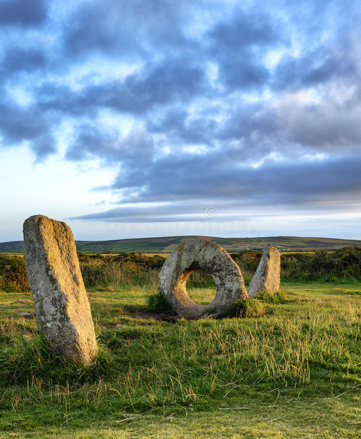 Men-An-Tol. The Men-an-Tol standing stones Near Penzance in Cornwall, local legend says that passing a person through the holed stone cures many ailments stock photography