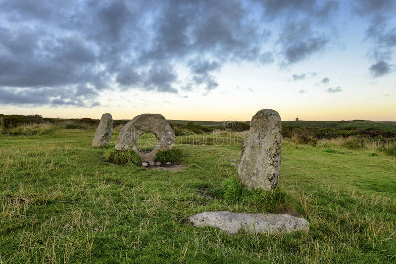 Men-An-Tol. The Men-an-Tol standing stones Near Penzance in Cornwall, local legend says that passing a person through the holed stone cures many ailments royalty free stock photo