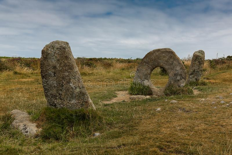 Men an Tol stones historic site, Cornwall. Men-an-tol historic site, in Cornish means `stone the hole`, standing stones are located near Madron in Cornwall royalty free stock photo