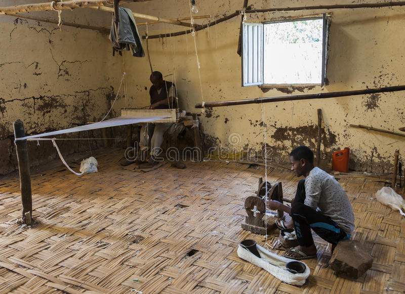 Men in traditional Dorze weaving house. Hayzo Village. Dorze. Et royalty free stock photos
