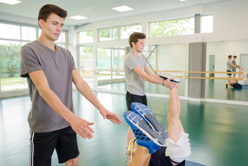 Men training with gym ball royalty free stock photos