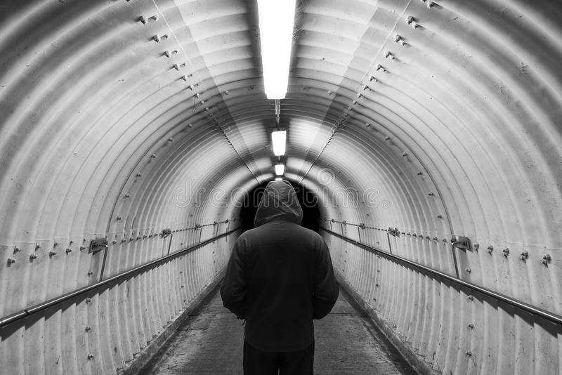 Men in tunnel stock image