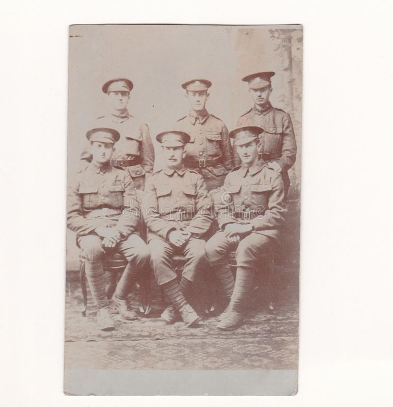 Vintage black and white photo postcard of men in army uniform 1916 - possbile Tank Regiment? royalty free stock image