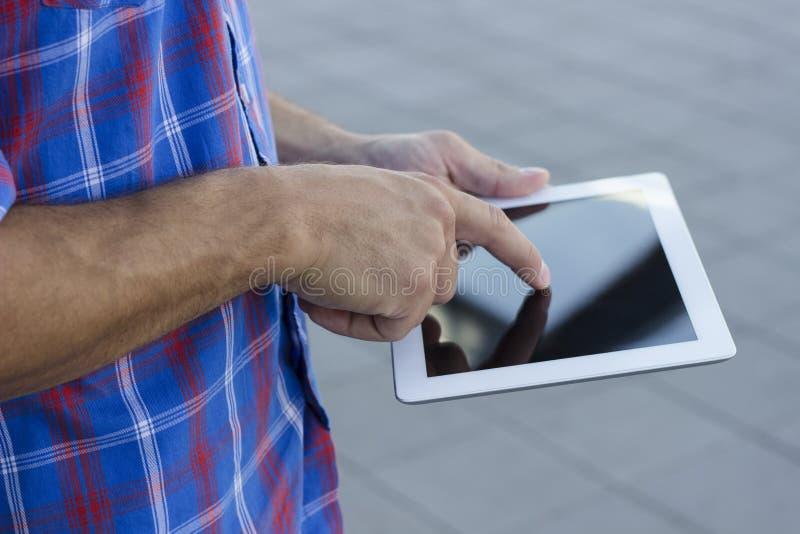 Men using digital tablet pc stock photos