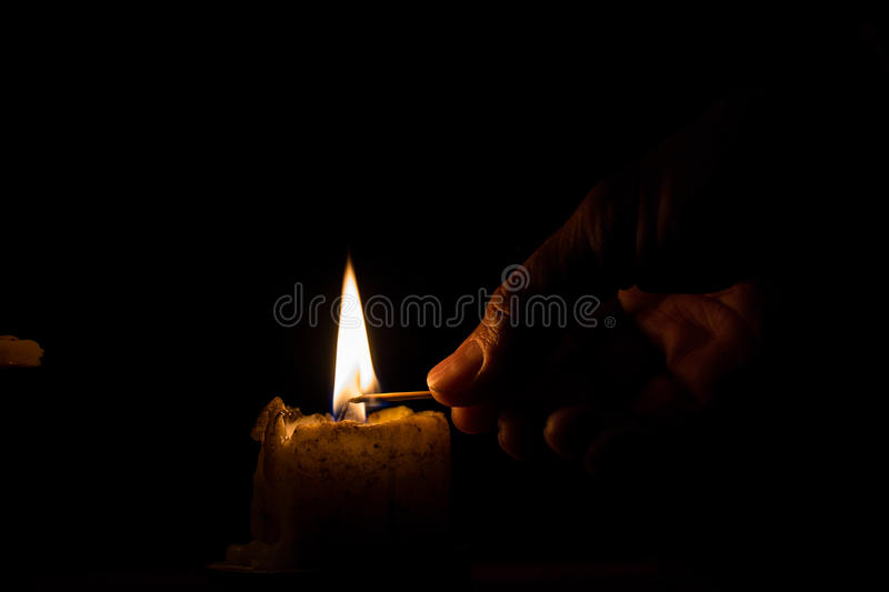 Men are using the match to light. stock photography
