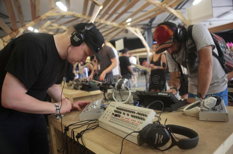 Men using music synthesizer mixing system at sonar festival wide. Musicians play and test mixing and composing sound systems during Sonar advanced technology royalty free stock images
