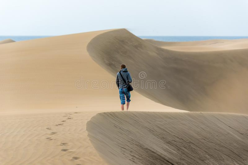 Men walking in the desert of gran canaria, spain stock photography