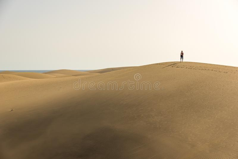 Men walking in the desert of gran canaria, spain royalty free stock photography