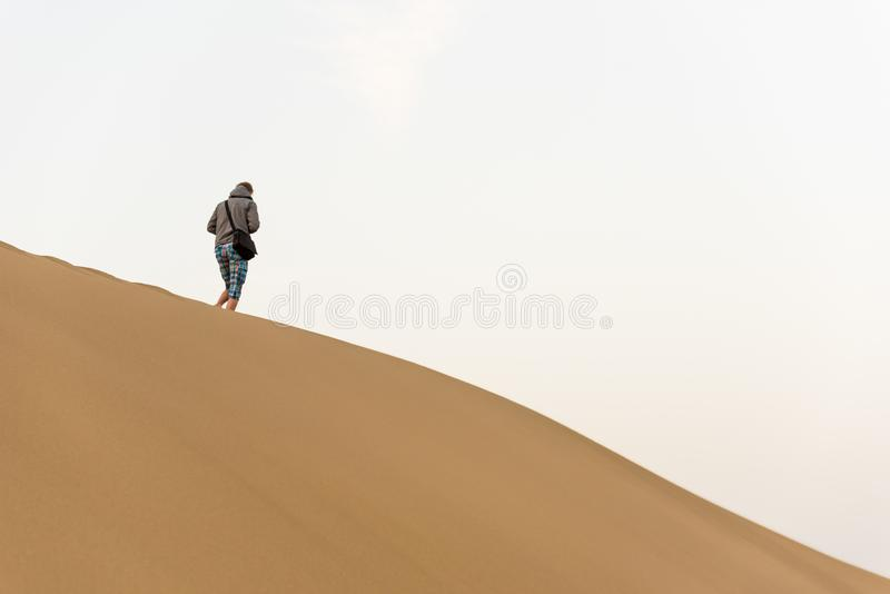 Men walking in the desert of gran canaria, spain royalty free stock photos
