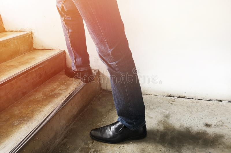 Men wear blue jeans and socks. walk up the stairs walk up the stairs , Positive and progressive ideas. Men wear blue jeans and socks. walk up the stairs stock images