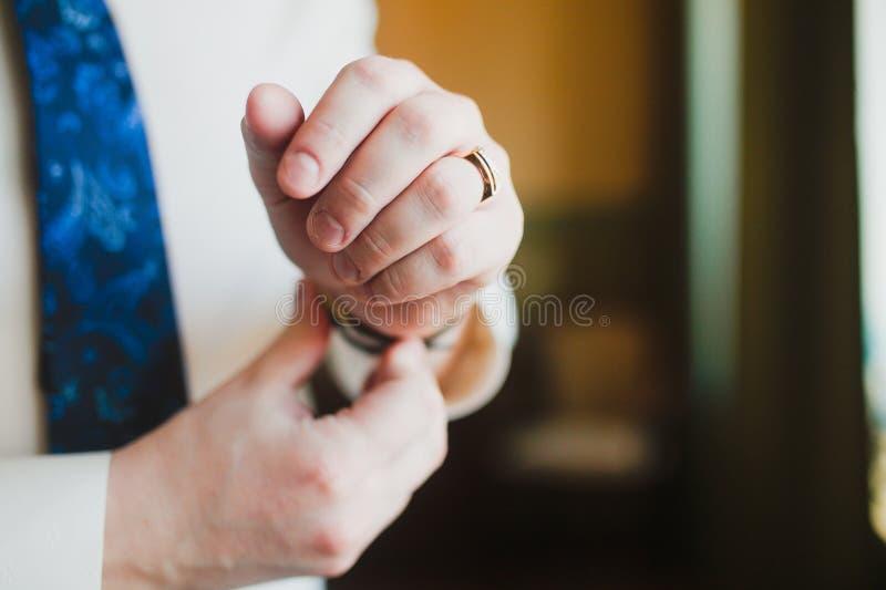Men wear a cufflinks royalty free stock photography