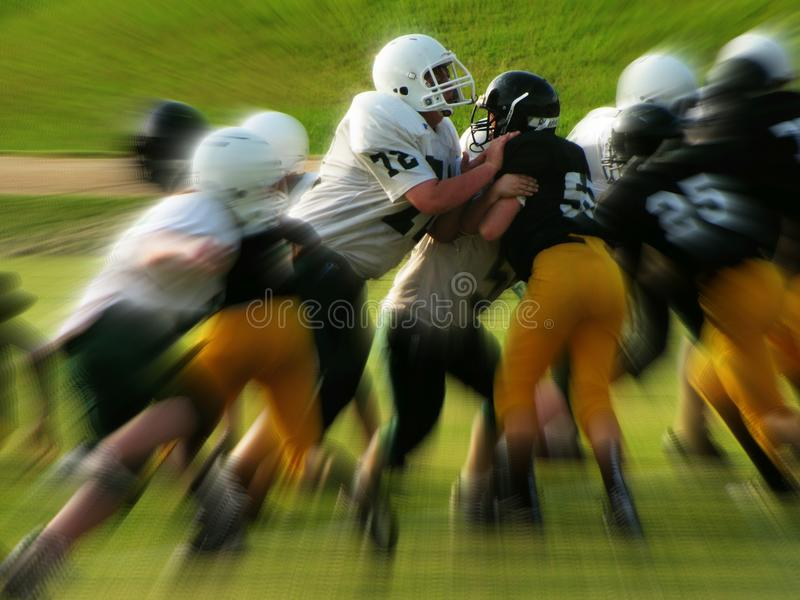 Men in White and Black Playing Football stock photo