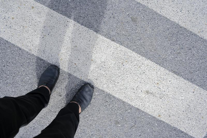 Men who are walking across the crosswalk royalty free stock images