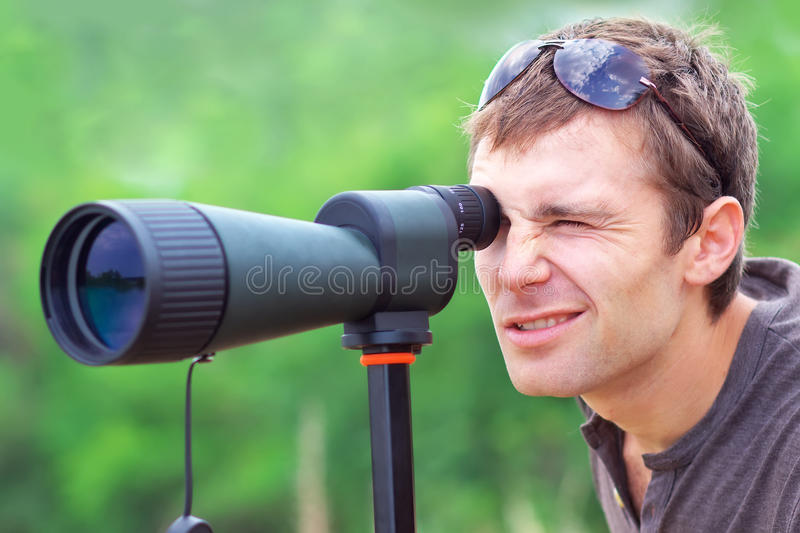 Men who is watching in spotting scope. stock photography