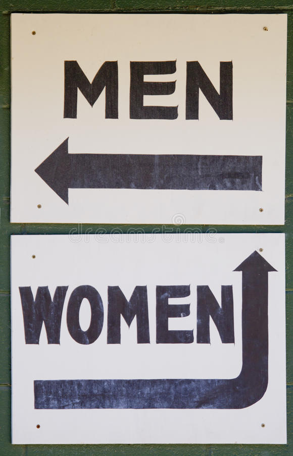 Men and Women Bathroom direction signs royalty free stock image