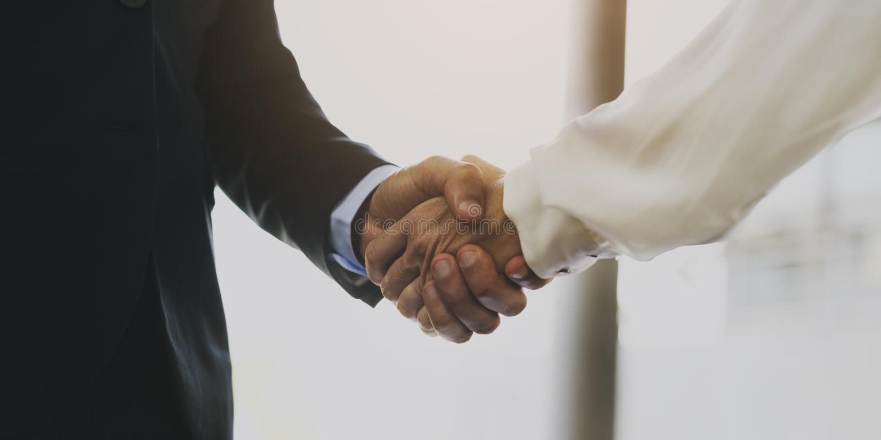 Men Women Business Agreement Hands Shake stock images