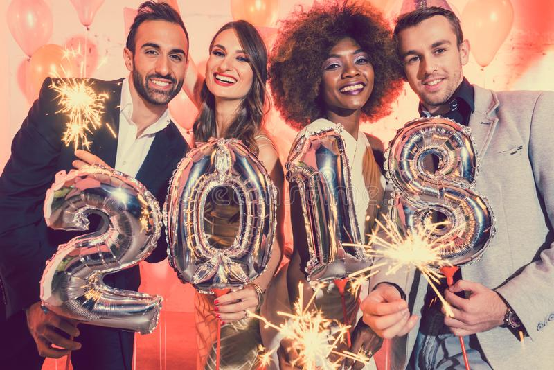 Download Men And Women Celebrating The New Year 2018 Stock Photo - Image of couple, black: 102359840