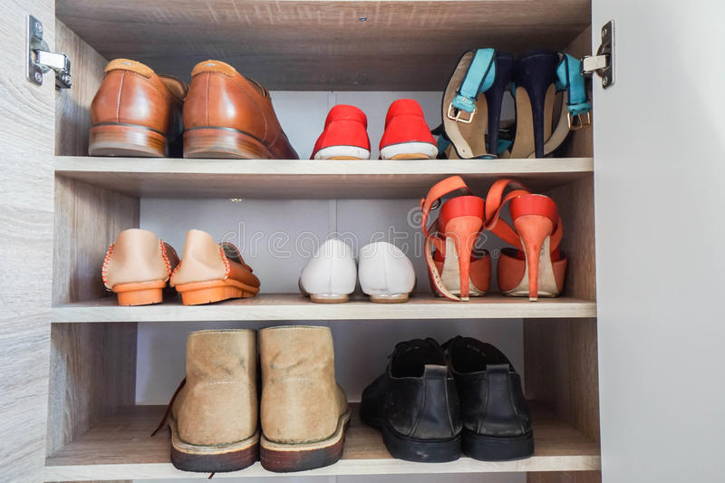 Men and women fashionable shoes in wardrobe stock photo