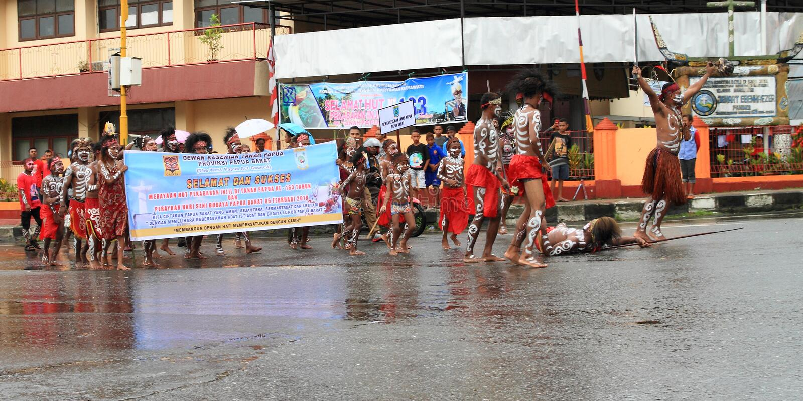 Papuans on celebration of first entry of missionaries. Men, women and kids from Dewan Kesenian Tanah Papua Provinsi Papua Barat - The West Papua Art Council - in royalty free stock photography
