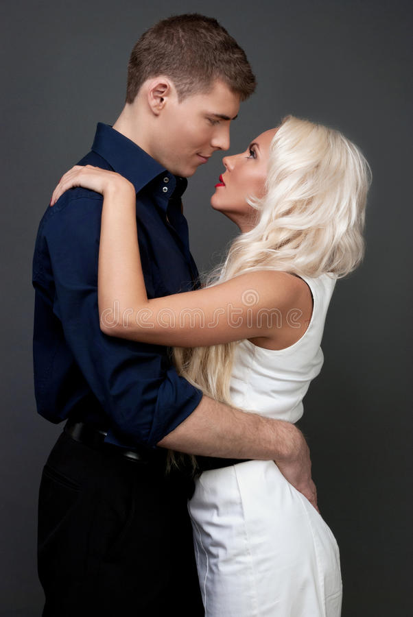 Men and women love. Tenderness love story. Handsome men and blond women passionately hugging. A loving relationship between a men and a woman. Love, passion royalty free stock photo
