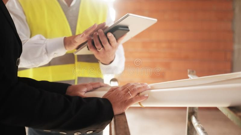 Female Architect and Foreman Meeting In Construction Site royalty free stock photography