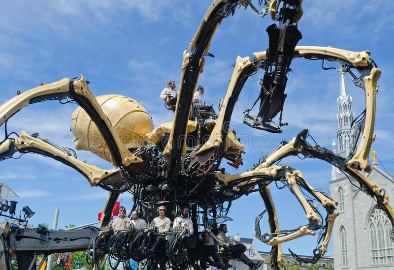 Men and Women operating a Giant Spider Kumo in Ottawa. Making its debut in North America, La Machine wanders around public spaces, in Ottawa, Canada. It is