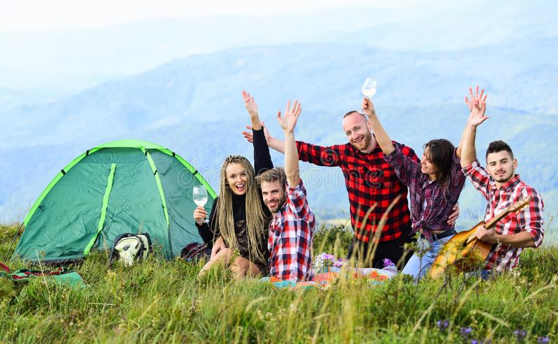 Men and women on picnic at tent. wanderlust discovery. mountain tourism camp. group of people spend free time together stock photo