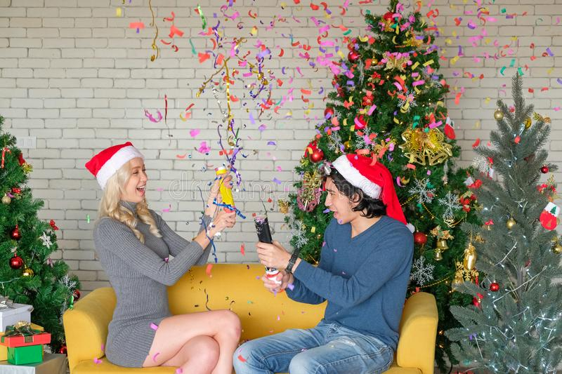 Men and women play Paper shoot Multi color on Christmas Day celebrate royalty free stock photography