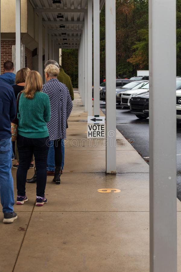 People waiting on line to vote in the US elections stock images